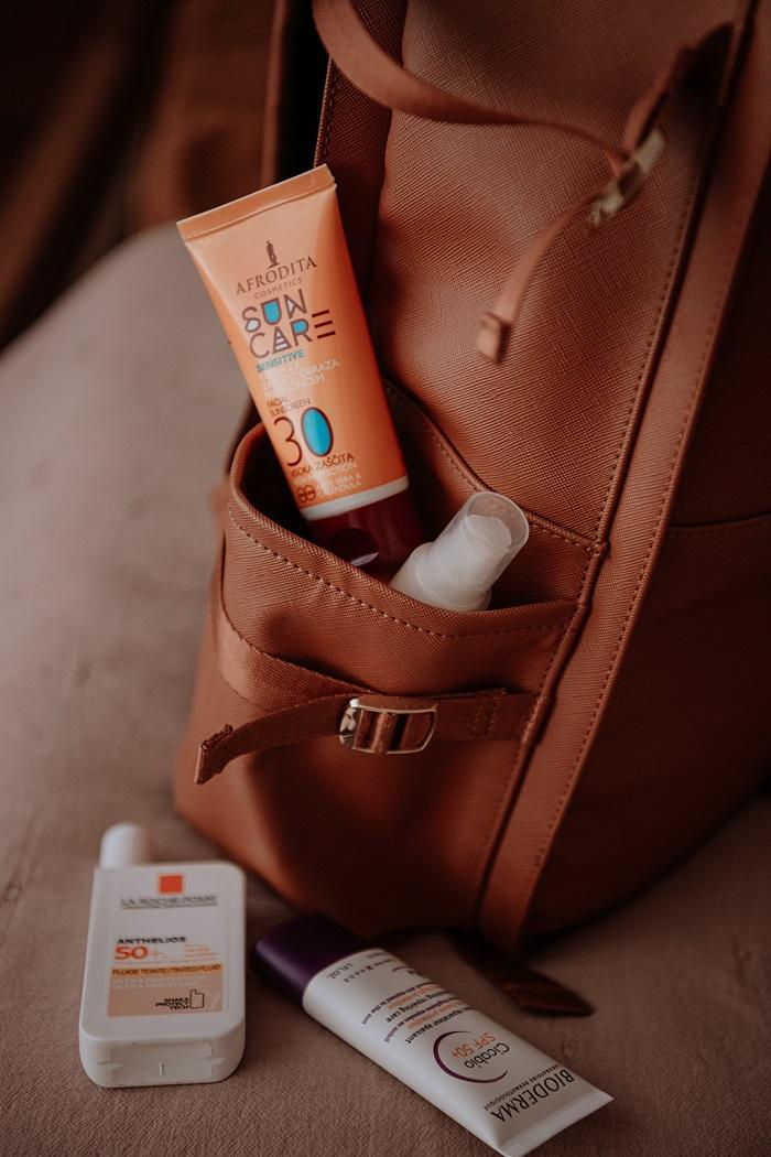 sunscreen in the backpack by Anastasija Thirsty for tan