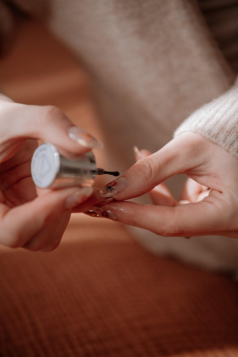 applying nail polish by Anastasija Thirsty for tan